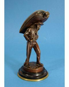 Bronzen beeldje, zakkendrager