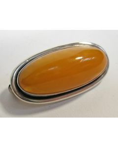 Zilveren broche met amber, door Carl Ove Frydensberg, ca.1950