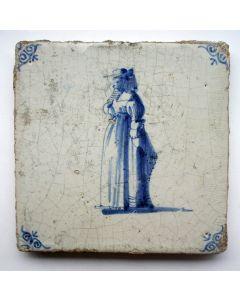 Figuurtegel, dame met hoed, ca. 1700