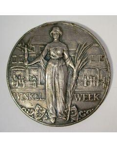 Zilveren penning, Winkelweek, aangeboden door W.H. de Beaufort
