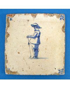 Tegel met kolfspeler, 17e eeuw