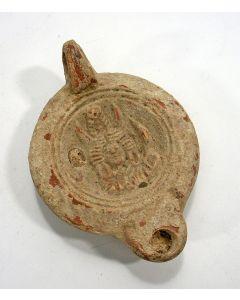 Romeins aardewerk olielamp met een godin, 3e/4e eeuw