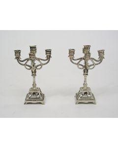 Stel miniatuur zilveren vijfarms kandelabers