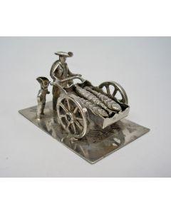 Zilveren miniatuur, visverkoper