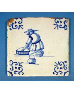 Figuurtegel, persoon met vismand, 17e eeuw