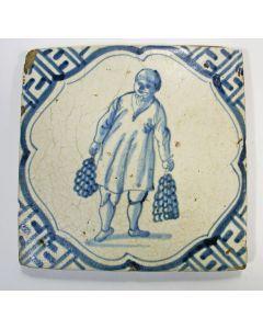 Figuurtegel, man met uien, 17e eeuw